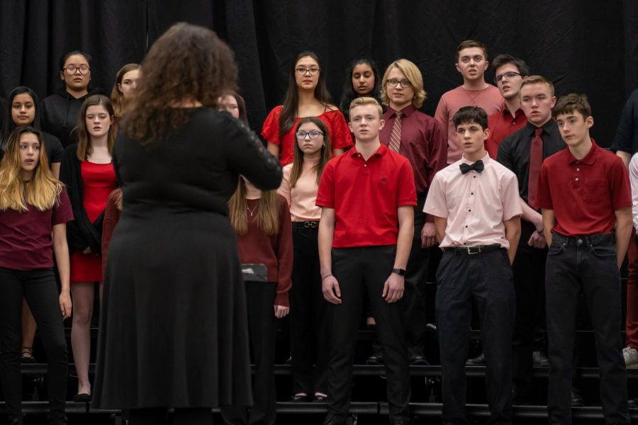 Director+Catherine+Lyon+conducts+the+Pleasant+Valley+Singers+at+District+Choral+Fest+held+in+the+PVHS+gym+on+Feb.+11.+