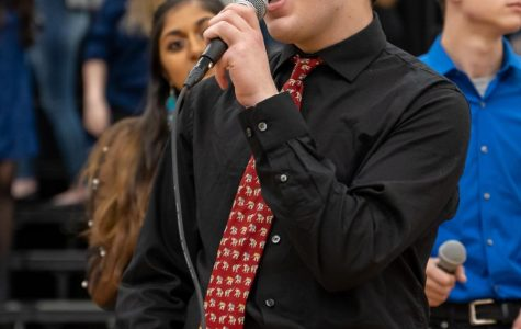 Freshman Tommy Glennon sings a duet in his jazz choir, Jazz Etc. at District Choral Fest held in the PVHS gym on Feb. 11.