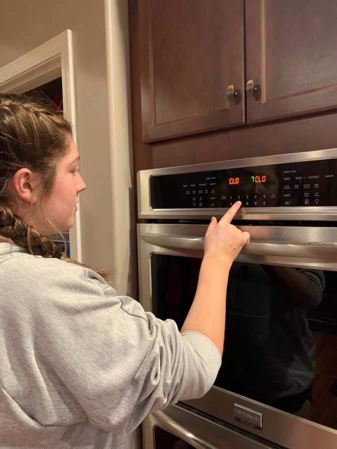 Freshman Molly Ramirez changes the clock in her kitchen to an hour later for Spring daylight savings.