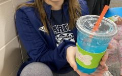 Caitlin Simon enjoys her highly caffeinated beverage before start of the school day.