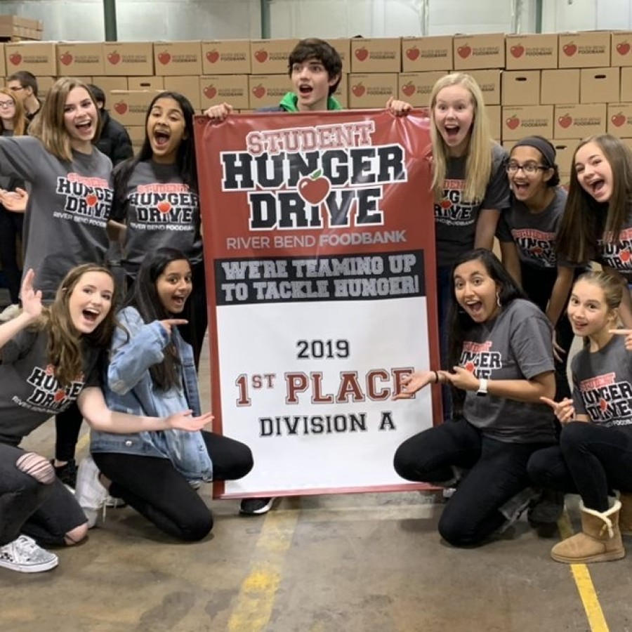 +Members+of+Spartan+Assembly+hold+the+banner+stating+that+Pleasant+Valley+won+first+place+for+the+student+hunger+drive+while+at+the+Riverbend+Food+Bank.+