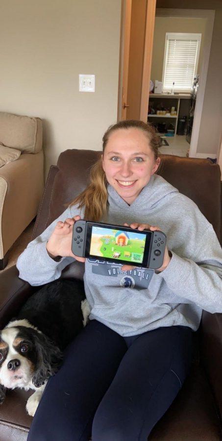 Senior Sara Hoskins displays a video game she uses to pass the time during self-quarantine.