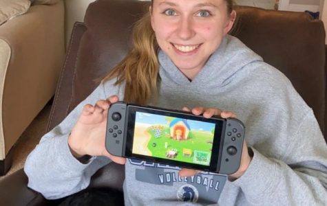 Senior Sara Hoskins displays a video game she uses to pass the time during self-quarantine.