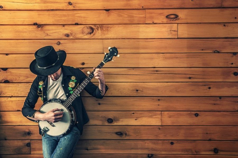 Country musician plays the banjo.