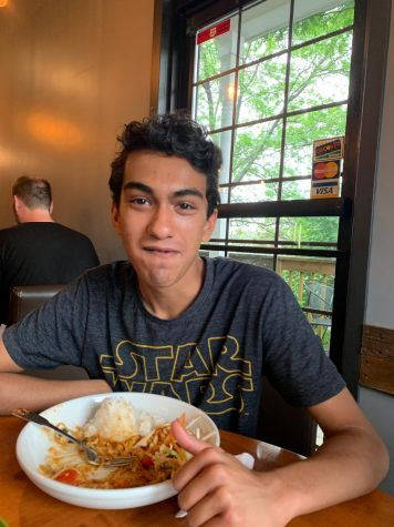 Senior Dilan Nair enjoys his gluten free Thai food at Exotic Thai in Davenport.