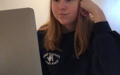 Senior Maddie Einck contemplates at home as to whether she should take the Pass grading option for her psychology class.