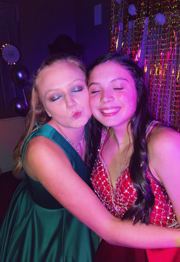 Seniors Lena Ahrens (left) and Morgan Ramirez (right) pose for a picture at their quarantine prom.