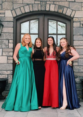 Seniors (left to right) Lena Ahrens, Clare Basala, Morgan Ramirez and Caroline Young pose for a picture before they attend their quarantine prom.