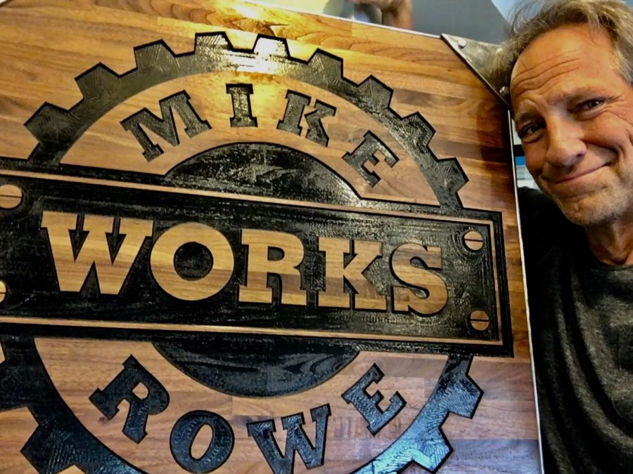 Mike Rowe poses in front of his foundation's logo as they near their 10th anniversary.