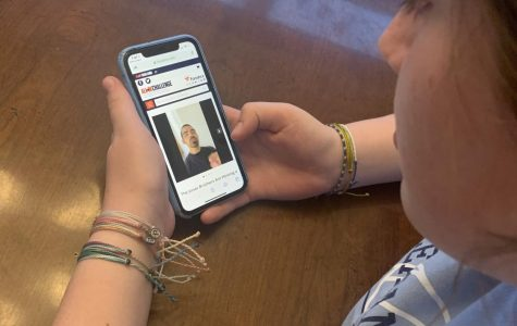 Freshman Molly Ramirez watches the Jonas Brothers' ALL IN Challenge video on the ALL IN Challenge website about what they are offering for the winner of their sweepstakes.