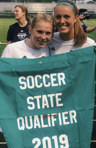 Senior Ellie Scranton and Junior Isabel Russmann pose for a picture after winning their soccer regional final game in 2019.