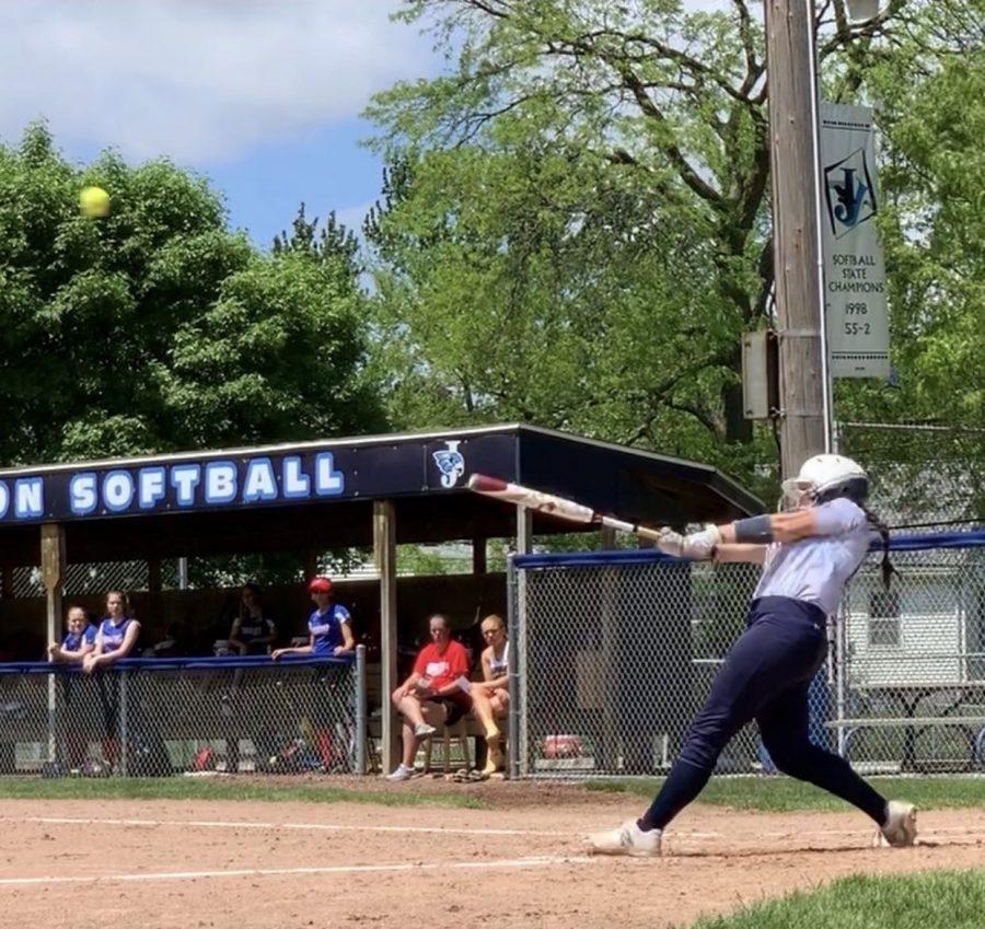 Senior Peggy Klingler swings the bat a tournament during the 2019 season.