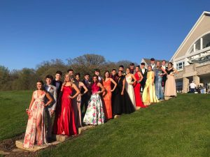 Students pose for prom pictures on May 5, 2019.