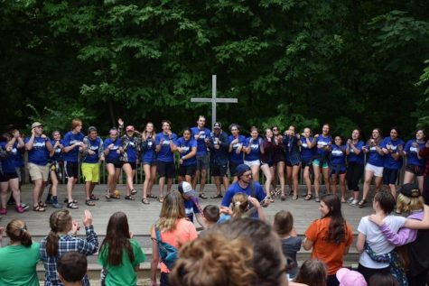 Senior Emma Meade and the rest of staff at Camp Shalom sing to the campers.