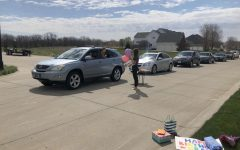 Senior Grace Halupnik receives a birthday car parade set up by her friends on her special day.