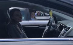 Seniors Emma Curtis, Hannah Anderson, and Lauren Steinhart social distance hang out from their cars during quarantine.