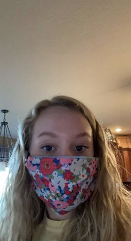 Sophomore Sidney Brockmann poses in a mask she made at home.