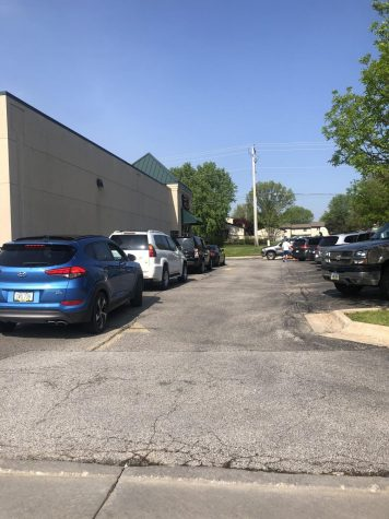 Cars wait in line at Coffee Hound in Bettendorf  on May 16. to support the local business during the Coronavirus pandemic.