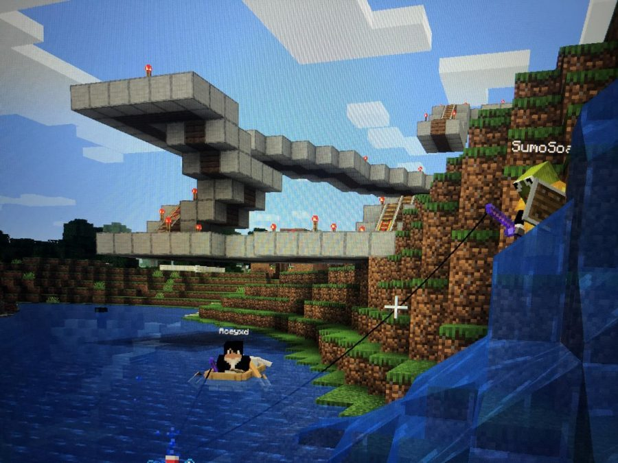 +Senior+Cienna+Pangen+shows+off+the+rollercoaster+she+made+in+Minecraft.