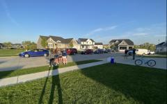 Seniors (left to right) Maya Johnson, Regan Denny, Ellie Scranton, and Jenna Aller stand in front of their senior night car parade put on by teammates.