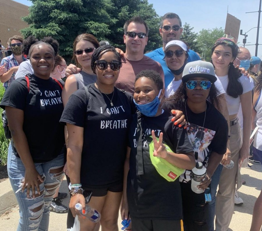 Corea Conner, at left,  attends the March to the Capitol on June 6 in downtown Des Moines with her mom, step-dad and a few new friends she met through her involvement with the Black Lives Matter movement.