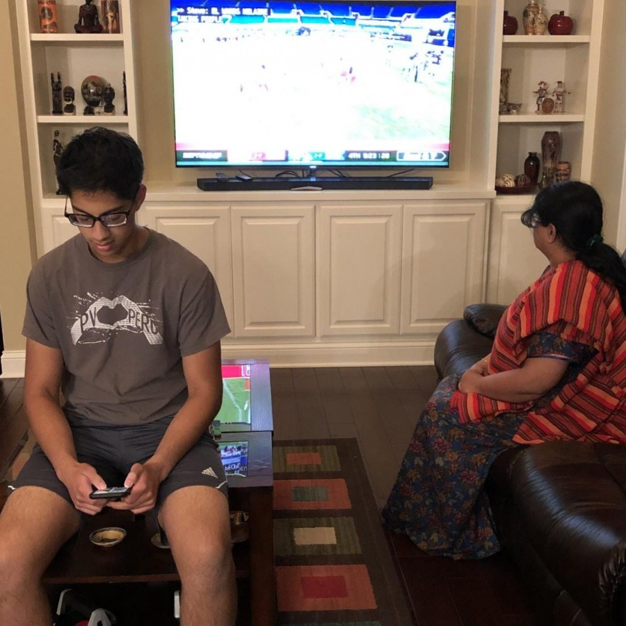 Avid NFL fans Akash Pradeep and Bhanu Ravindran watch the Packers vs Saints game on Sunday September 27, 2020. Ravindran watches the game in support of the league's use of their social platform for protest while Pradeep looks away in disapproval.