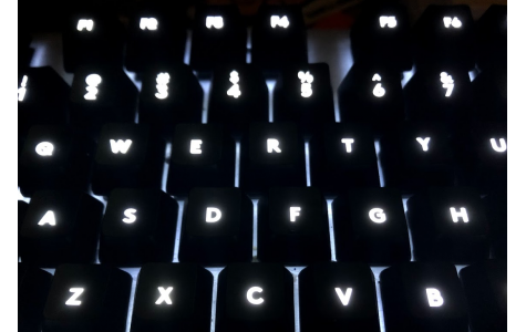Photo of a backlit keyboard at night.