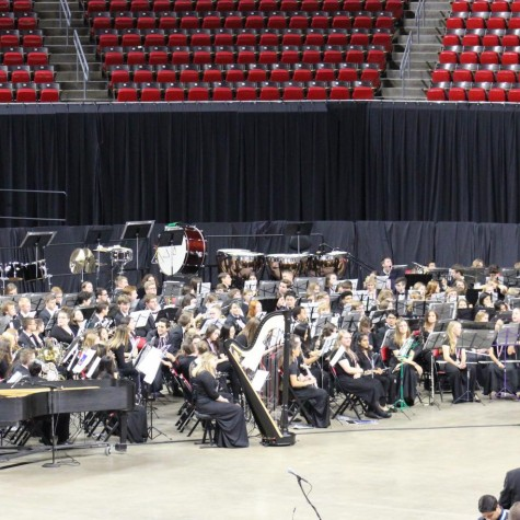 The 2019 All-State band before their performance in the Hilton Coliseum on the Iowa State Campus. Most members have been preparing for this moment for more than six months. However, with this year's auditions being online many are concerned that audio quality and technology of recording devices may be the deciding factor to get to this moment.