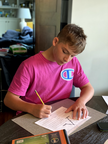 Alex Van Utrecht works on school work during his at home day.