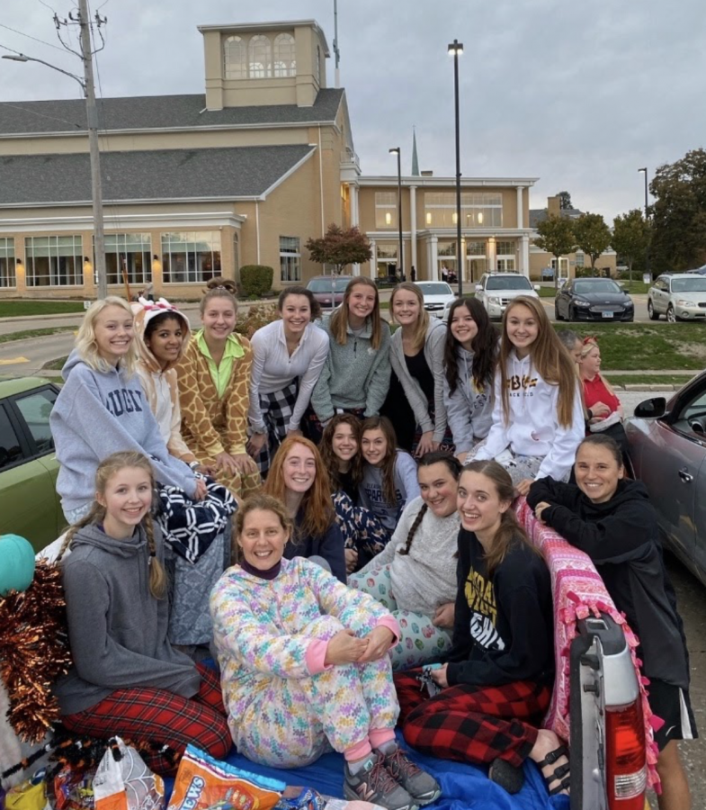 "Anna Thorne and her Church group celebrate their trunk's pajama and slumber party themed trunk from 2019's trunk-or-treat activity. Trunk-or-treat is listed as a ""moderate risk"" when it comes to staying safe from COVID-19, if done the correct way. This is just one of the many activities that people can participate in while being healthy for this year's Halloween."