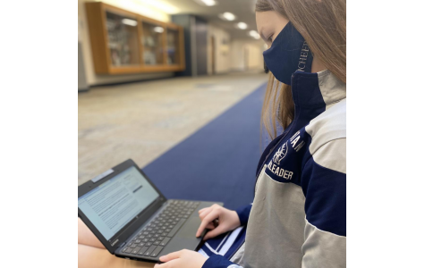 Senior Addi Steele reads an article that outlines Judge Amy Coney Barrett's conservative views on abortion