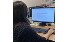 Business teacher Janene Murphy navigates through Google products to create a calendar for the week.