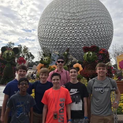 Seniors Nathan Lokenvitz, Srikanth Ganesh, Kyle Sehlin, Sam McGrath, Sam Noel, Will Pendrak, and Micahel Musal pose in Epcot, Florida in March 2018.