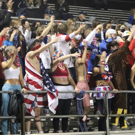The PV student section cheering on the football team during the Sept. 11 game against Muscatine.