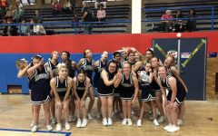 The Sparkles cheerleading team gathers for a picture before their halftime performance at Hoops for Hope at Davenport Central High School in September, 2019.