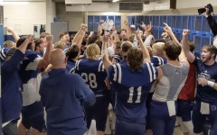 The Pleasant Valley football team celebrates in the locker room after beating Iowa City West on Nov. 6.