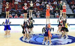 The 2018 Iowa All-State cheerleaders stunt during their performance for the boys basketball state tournament.