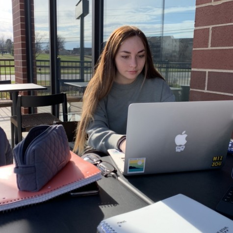 Senior Emma Cramer doing her online school work at Starbucks.