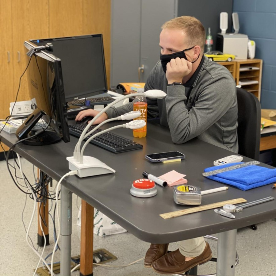 Teacher Grant Housman checks his 150 new emails in the morning.