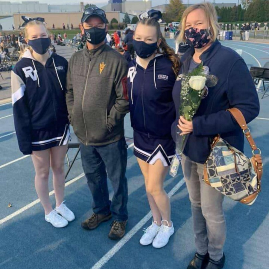 Addi Steele and her family at one of her many football games in which she cheered at.