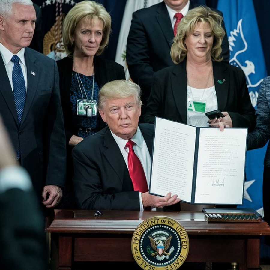 President Donald Trump signs the Border Security and Immigration Enforcement Improvements order on Jan. 25, 2017.