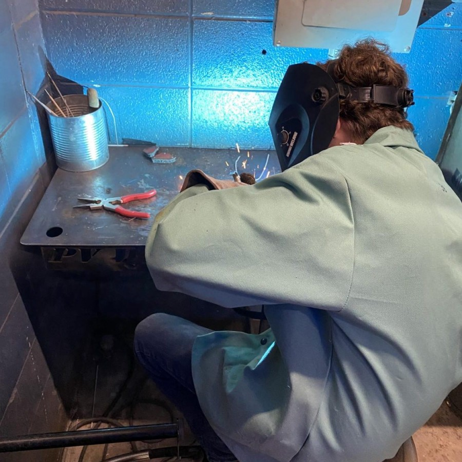 Despite negative stigmas surrounding welding, Arik Queal continues the development of his trade during his metals class.