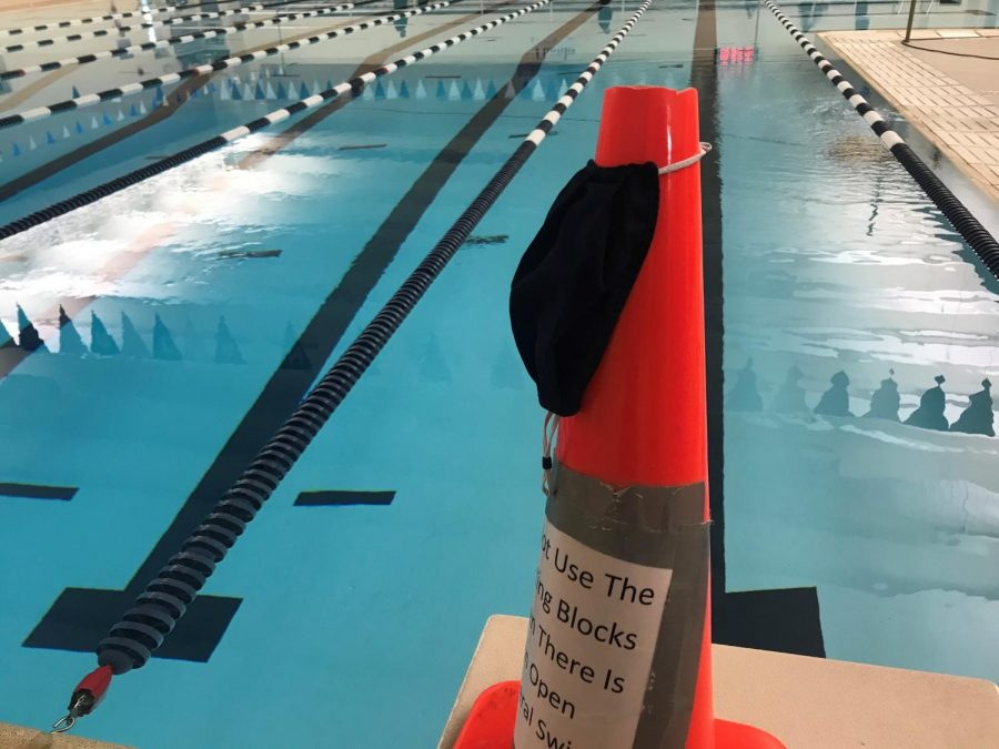 In order to adhere to COVID guidelines, swimmers are required to wear masks up until they enter the water have to space themselves out across the pool.