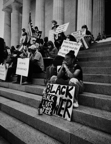 Black Lives Matter activists sit at the capital stairs fighting their peaceful fight.