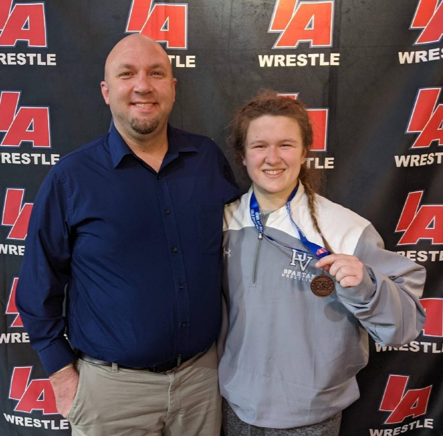 Junior+Aine+Moffitt+and+her+coach%2C+Tom+Isaacson%2C+after+she+placed+4th+at+the+girls+wrestling+state+championship+tournament+on+Jan.+23+and+24.