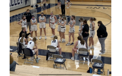 Pleasant Valley Girls Basketball team in huddle during their game against Davenport North on Feb. 5.