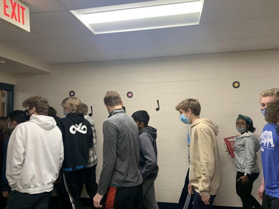 Pleasant Valley students shuffle their way through a crowded hallway during a passing period.