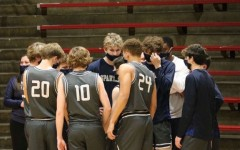 Pleasant Valley's boys basketball team huddles to motivate and hype themselves up before returning to the court to face off against North Scott on Dec. 8, 2020.