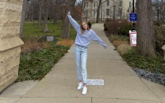 Alyce Brown stands with open arms, embracing her acceptance into Northwestern University, as she looks to a prosperous future in journalism beyond Iowa.