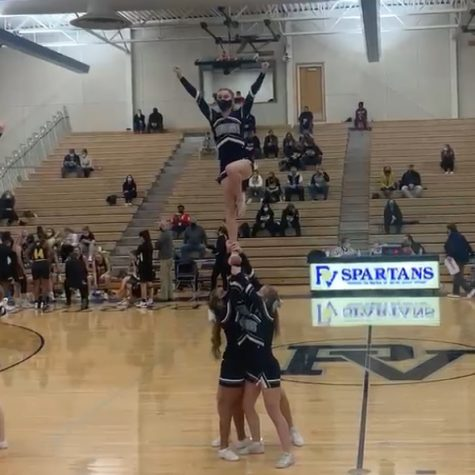 Savannah Ervin flys a lib- after many years of basing- for her stunt on senior night, just a few games before her last.